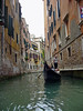 Gondlier plies the canals of venice - Venice - Italy