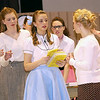 """Record-Eagle/Garret Leiva<br /> Kelley Ritsema, as Jane, helps Miss Brooks pass out copies of 'Lost Horizon' to the eager students gathered to audition for a role in the school play in a scene from the Traverse City Christian High School production of """"Our Miss Brooks."""""""