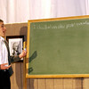 """Record-Eagle/Garret Leiva<br /> Alex Heald, in the role of Ted, writes out his punishment for copying another student's exam in a scene from the Traverse City Christian High School production of """"Our Miss Brooks."""""""
