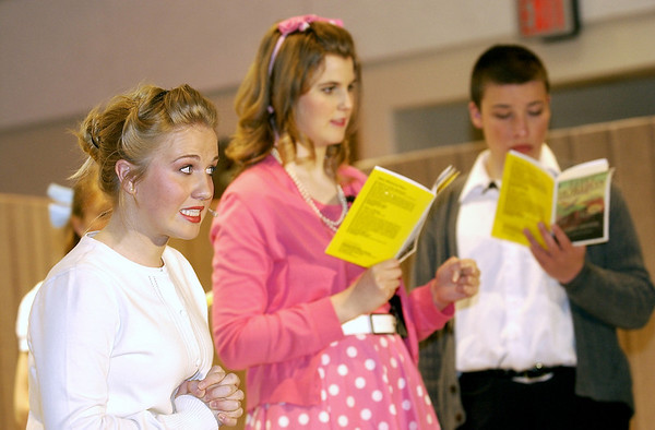 "Record-Eagle/Garret Leiva<br /> Debby Fay, as Miss Brooks, informs the girls she has plenty of tissues on hand for tears after they don't get their part in the school play in a scene from the Traverse City Christian High School production of ""Our Miss Brooks."""