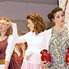 """Record-Eagle/Garret Leiva<br /> Arielle Kanitz, as domineering school board member Mrs. Allen, makes a big production of her expensive vases that will be used as props in the school play in a scene from the Traverse City Christian High School production of """"Our Miss Brooks."""""""