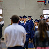 Special to the Record-Eagle/Keith King<br /> Alec Presley, left, and Maria Piché, right, enter the Traverse City St. Francis High School gymnasium with their fellow graduating seniors Sunday at the start of the Traverse City St. Francis High School commencement.