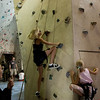 Samantha and Megan in a race to the top.  Sam's mom to the left, holding the belay line.