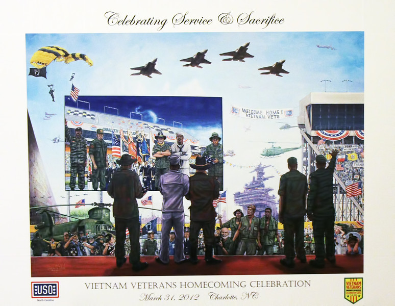 """Vincent Wood, who actually was working on this painting during the Vietnam Homecoming at Charlotte Motor Speedway on March 31, 2012, has completed it and is now accepting orders for limited edition canvas transfers and lithographs.  He is donating a generous portion of the proceeds to the USO in support of our troops.  It is a BEAUTIFUL painting, and this image of it doesn't come close to doing it justice.  If you'd like to add a great piece of artwork to your collection and support our men and women in the military at the same time, orders can be placed at <a href=""""http://www.uso-nc.org/get-involved/gift-shop"""">http://www.uso-nc.org/get-involved/gift-shop</a>, or directly from the artist at  <a href=""""http://www.twinartists.com"""">http://www.twinartists.com</a>  THANKS for your support!!"""
