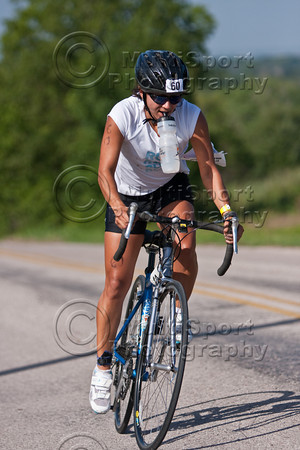 While trying to drink some water, this rider decides she needs both hands to climb the last hill on the bike course.