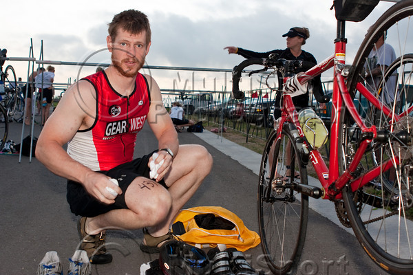 An athlete prepares his transition area prior to the race start.