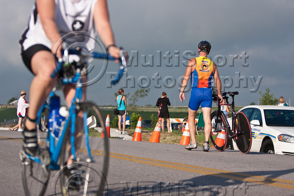 After having a flat tire shortly after starting the bike course, this athlete decides to walk back to the transition area for repairs.