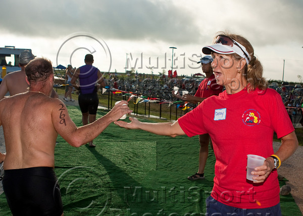One of the many volunteers helps to make sure the participants stay hydrated.