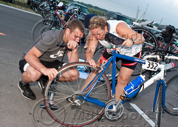 A participant gets some help with a bike tire problem.