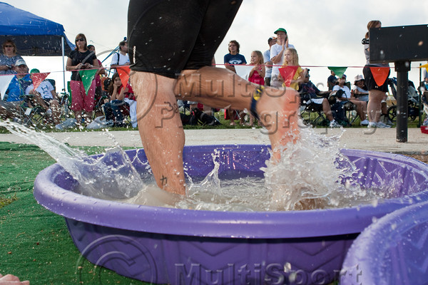 After the swim, participants use a wading pool to wash sand off their feet on their way to the bike transition.