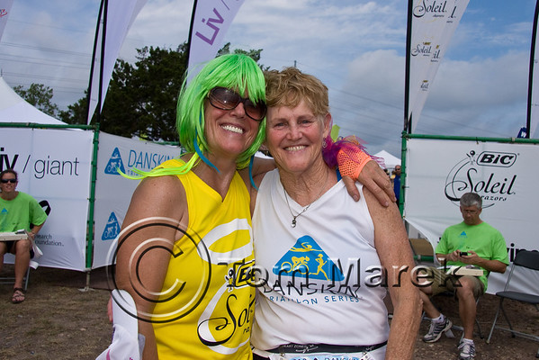 Ardis Bow (L) and Sally Edwards of the Danskin Triathlon Series pose for a finish line photo.