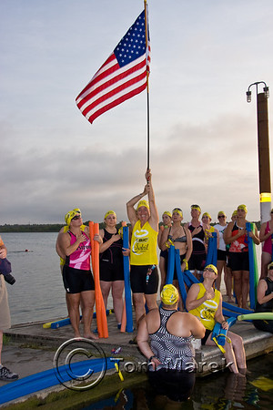 Ardis Bow of the Danskin Triathlon Series proudly holds the flag during the singing of the National Anthem.
