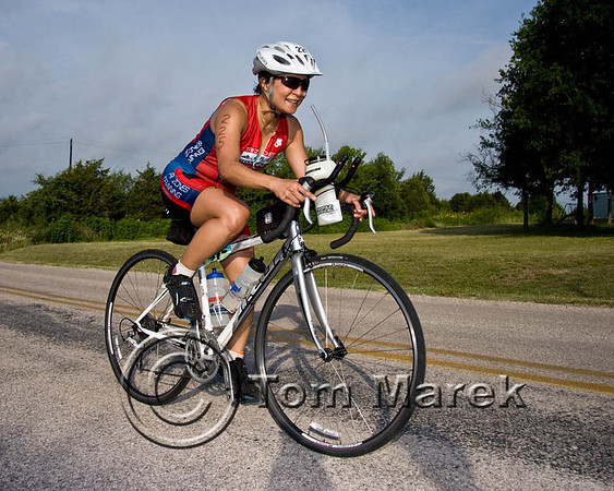 Athlete Kim Gutierrez finishing the bike leg of the triathlon.