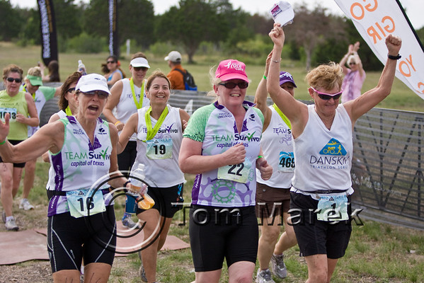 Sally Edwards (R) proudly escorts members of Team Survivor to the finish line.