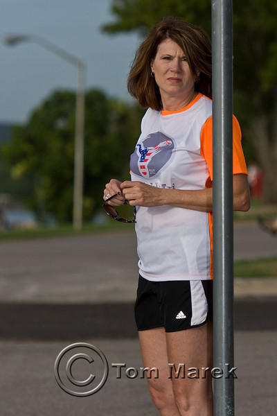 A volunteer awaits inbound cyclists to help guide them to the transition area where they will begin the run