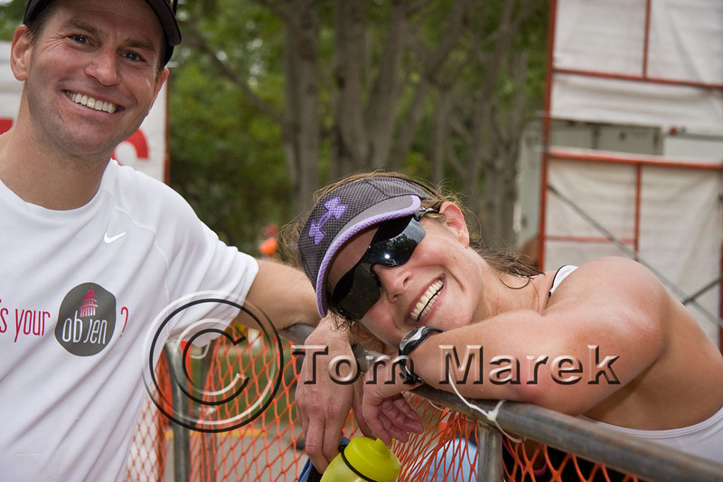 A tired athlete rests on the fence just after finishing the Marble Falls Triathlon