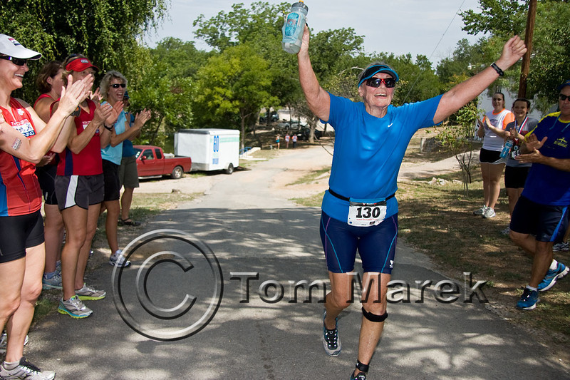 Austin athlete, 74 year old Jody Kelly, finishes the Marble Falls Triathlon
