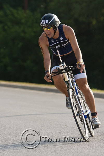 Athletes execute a high speed turn just before arriving at the transition area