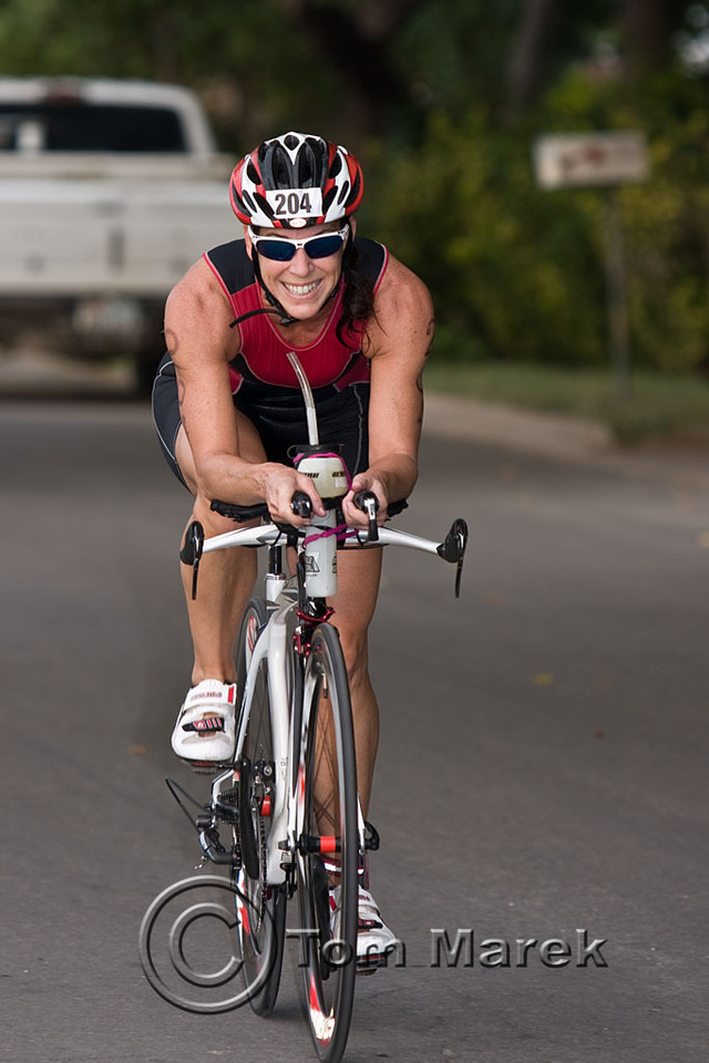 Marble Falls athlete Denise Rhodes heads out on the bike portion of the triathlon.