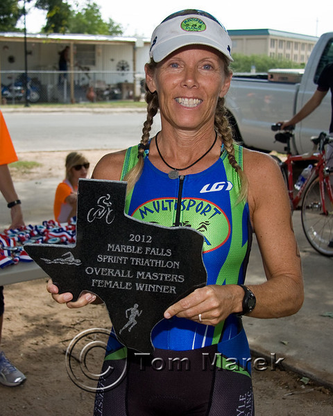 An athlete receives her award for overall female masters winner