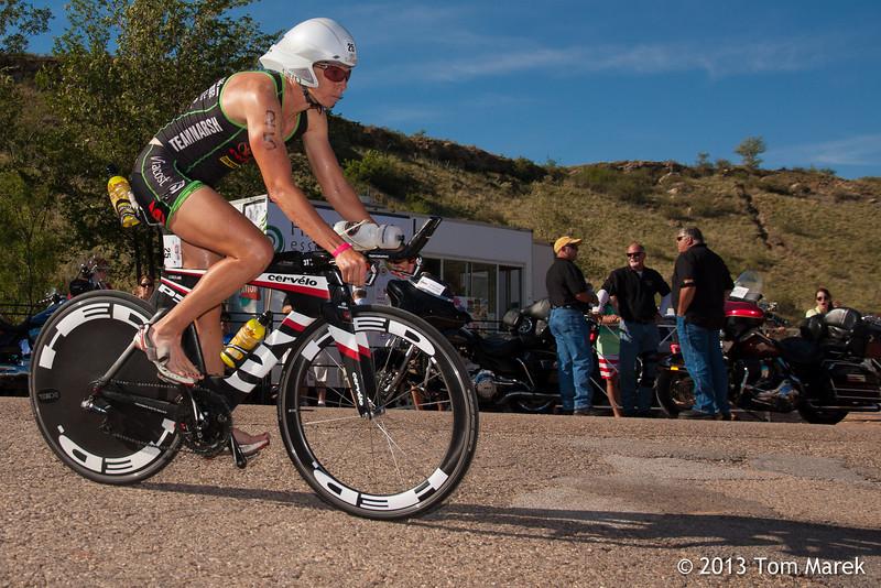 Austin professional athlete Amy Marsh heads back to the transition area to begin the half-marathon run.