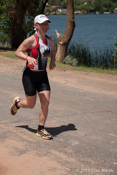 Austin athlete Michelle Garel heads toward the finish line on the bank of Buffalo Springs Lake.