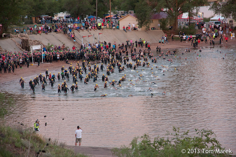 A wave of athletes start the 1.2 mile swim portion of the triathlon.