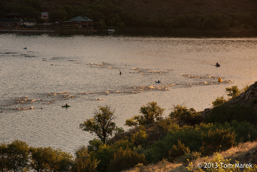 As the sun rises over Buffalo Springs Lake, athletes navigate the second turn of the swim course.