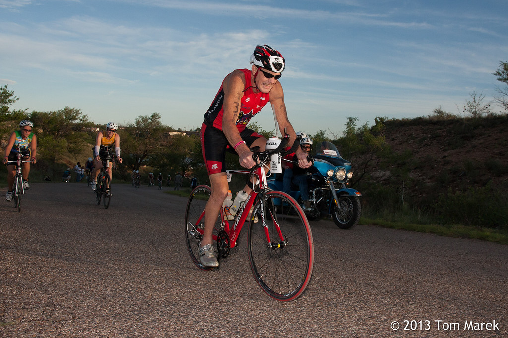 Garry Elmitt from Austin makes the final push toward the top on the first hill on the bike course.