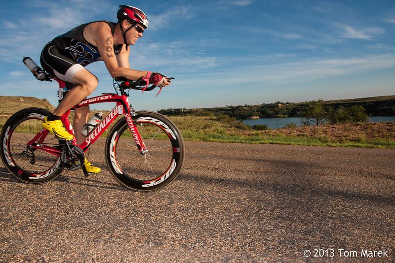 Jeff Jenkins from Levelland, TX enjoys a brief rest as he speeds downhill toward the dam.