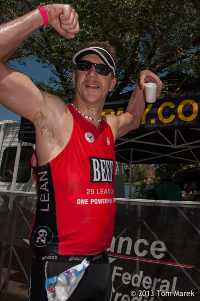 Kenneth Betts from Hutto, TX celebrates his finishing the 2013 Buffalo Springs Lake Triathlon.