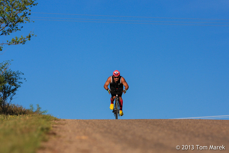 After the tough climb, this athlete attacks the downhill to build speed.