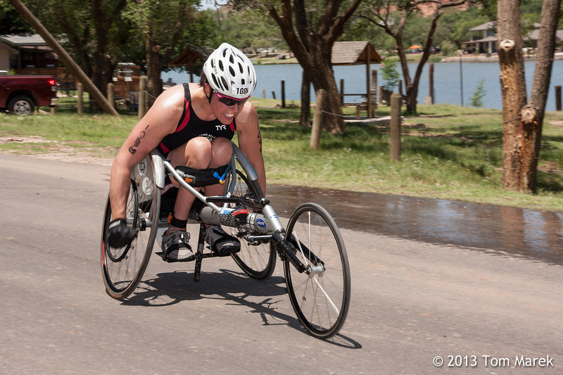 Susan Katz from Chicago, drives her wheelchair toward the finish line.