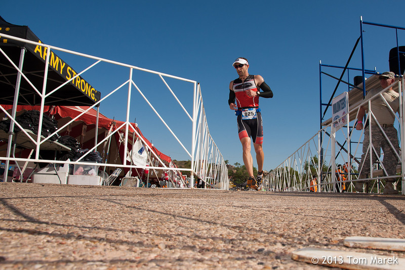 An athlete begins the 13.1 mile run leg of the triathlon/