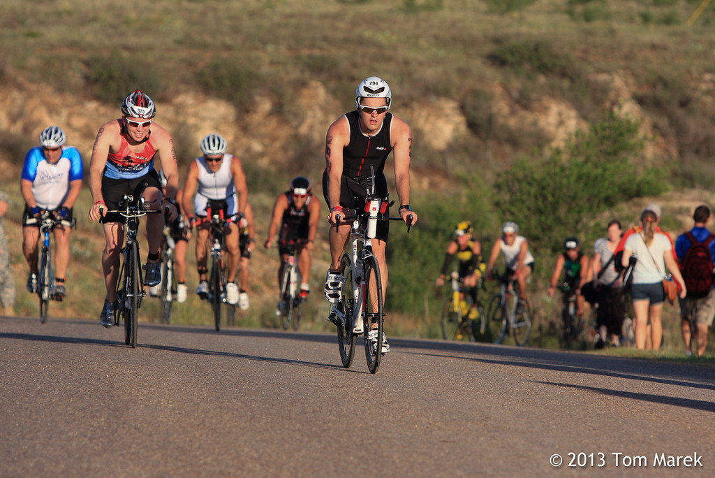 Athletes near the top of the first hill on the bike course.