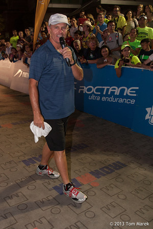 "Mike Riley, the ""voice of Ironman,"" keeps the crowd energized as the clock ticks closer to the midnight cutoff."