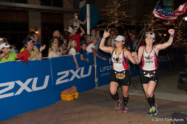 Physically challenged athlete Rachel Weaks (Irne, SC) teathered to her escort Caroline Gaynor (NY, NY) celebrate their finish of Ironman Texas