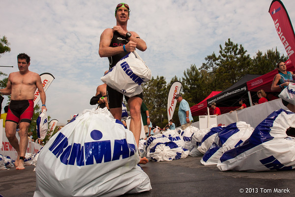 Atheletes wade through a sea of bags containing items they will need for the bike portion of the race.