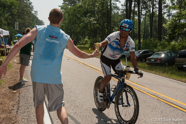 Athletes get fresh food and fluids as they roll throug one of the many aid stations along the bike course.