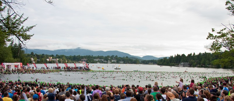Swimmers spreadding out to try and get the best line on the swim course.