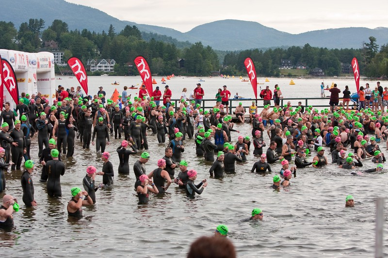 Athletes getting in the water for the mass swim start.
