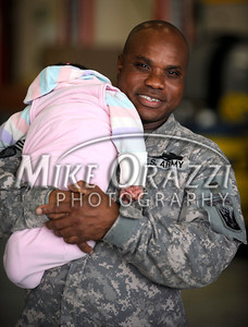 11/17/2010 Mike Orazzi | Staff Staff Sgt. Novel Harris of Washington State holds his grand daughter Katalina Richeme after he arrived at Bradley Airport with fellow soldiers from the 1st Battalion, 102nd Infantry and Company F, 186th Brigade Support Battalion (BSB) of the Connecticut Army National Guard on a Delta flight Wednesday morning, November 17, 2010 after serving in Afghanistan since January.