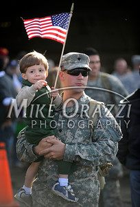 11/17/2010 Mike Orazzi | Staff james Oliver holds his two year old son Devin after arriving with fellow members of the 1st Battalion, 102nd Infantry and Company F, 186th Brigade Support Battalion (BSB) of the Connecticut Army National Guard after he arrived at Bradley Airport on a Delta flight Wednesday morning, November 17, 2010 after serving in Afghanistan since January.