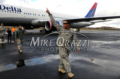 11/17/2010 Mike Orazzi | Staff Soldiers from the 1st Battalion, 102nd Infantry and Company F, 186th Brigade Support Battalion (BSB) of the Connecticut Army National Guard arrive at Bradley Airport on a Delta flight Wednesday morning, November 17, 2010 after serving in Afghanistan since January.