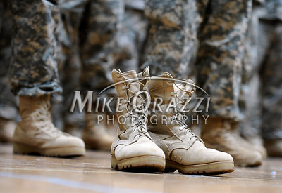 2/12/2011 Mike Orazzi | Staff Any empty pair of boots among the approximately 600 soldiers from the 1st Battalion, 102nd Infantry Regiment, headquartered in New Haven honored in a formal welcome home ceremony at the William A. O'Neill Armory in Hartford on Saturday, February 12, 2011.
