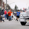 Record-Eagle/Keith King<br /> Nathaniel Fleming, left, 10, of Kalkaska, and Devin Cuadros, 11, of Alden, run as candy is thrown Saturday, April 30, 2011 during the National Trout Festival Great Lakes Energy Grand Royale Parade in Kalkaska.