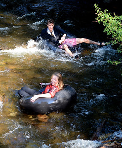 Lana Malone, bottom, and Tanner Hayes, head down Boulder Creek during the 5th annual Tube to Work event at Eben G. Fine Park in Boulder on June 29, 2012. For more photos and a video  of the commute, go to www.dailycamera.com. Cliff Grassmick / June 29, 2012