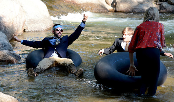 "John Powers, left, gets his tubing game face on before the start of the 5th annual Tube to Work event at Eben G. Fine Park in Boulder.<br /> For more photos of the commute, go to  <a href=""http://www.dailycamera.com"">http://www.dailycamera.com</a>.<br /> Cliff Grassmick / June 29, 2012"