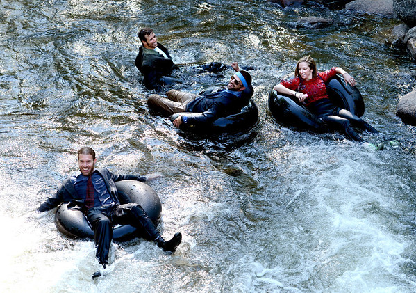 """Quayle Hodek, bottom, left, Jake Adams, John Powers, and Lana Malone, travel down Boulder Creek as part of the 5th annual Tube to Work event on June 29, 2012 in Boulder, Colorado.<br /> For more photos and a video of the commute, go to  <a href=""""http://www.dailycamera.com"""">http://www.dailycamera.com</a>.<br /> Cliff Grassmick / June 29, 2012"""