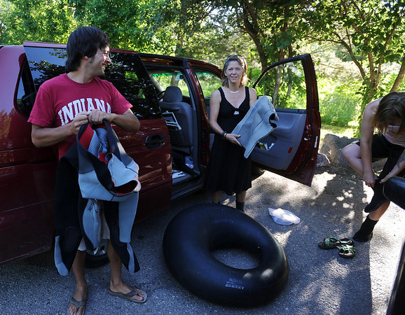 Jeff Kagan, left, Christina Allen, and Allison Marriott, get ready to tube to work on Friday.<br /> Cliff Grassmick / June 25, 2010